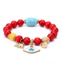 Fatima keze karkötő piros színű türkiz kővel
