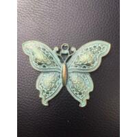 Antikolt pillangó medál