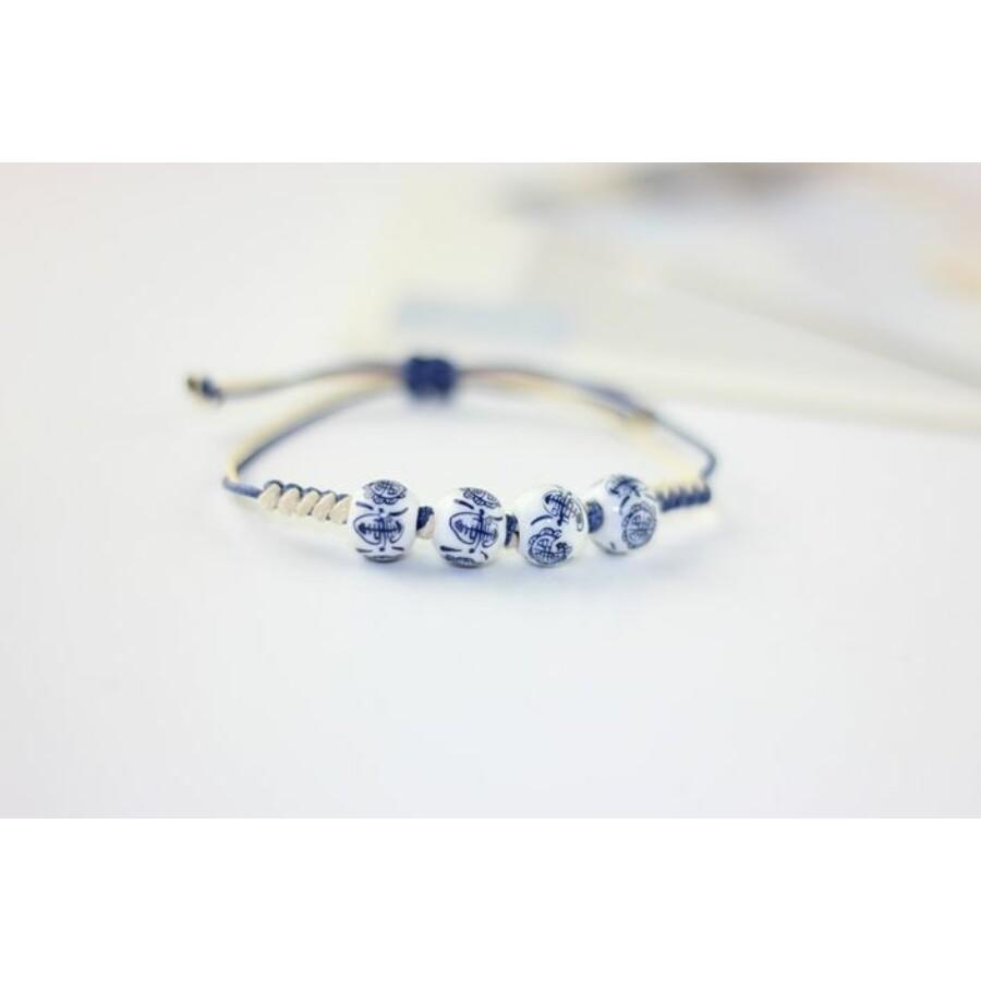 Kék virágmintás shamballa porcelán karkötő